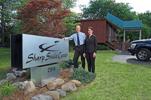 Dr. Sharp & Dr. Mitchell on the front lawn of their Kalamazoo dental practice