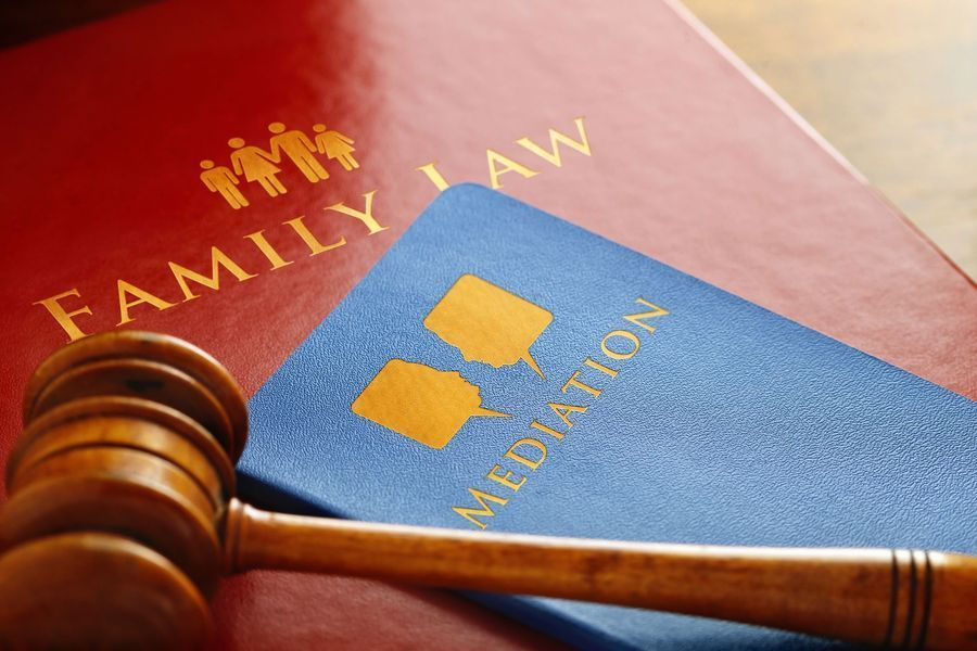 Legal books titled Family Law and Mediation with gavel