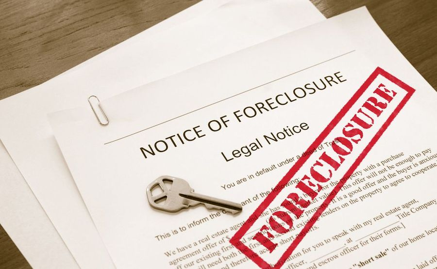 Foreclosure paperwork and house key