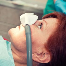 Photo of a woman receiving nitrous oxide