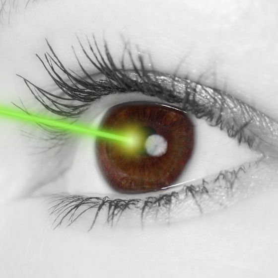 Close-up image showing a green laser contacting an eye
