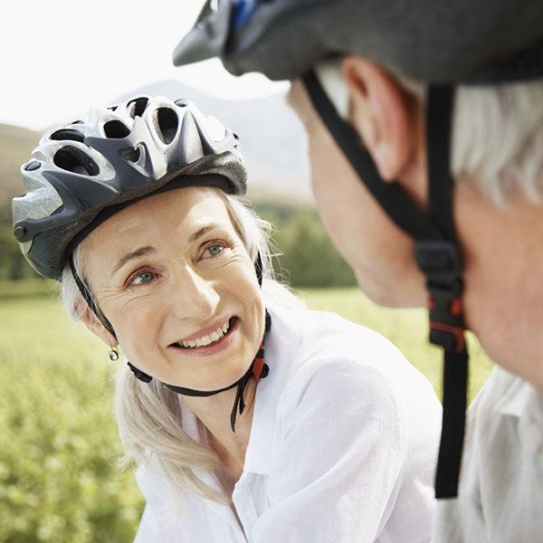 An older woman smiling during a bike ride