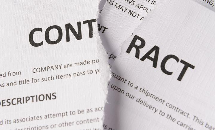Torn contract paperwork