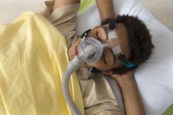 man wearing CPAP machine