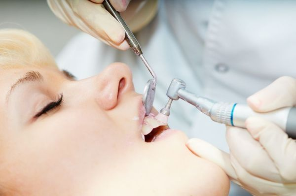 A hygienist performing a dental cleaning