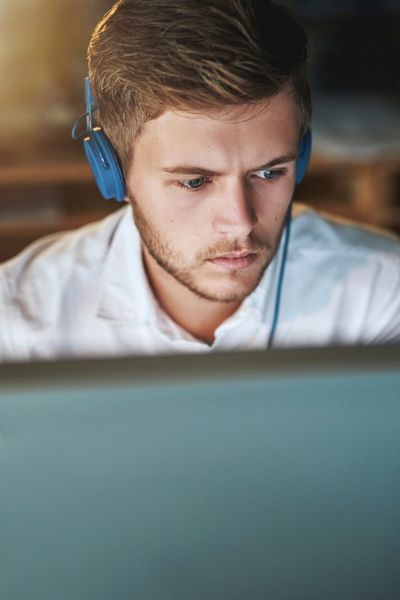 Photo of young man using a computer