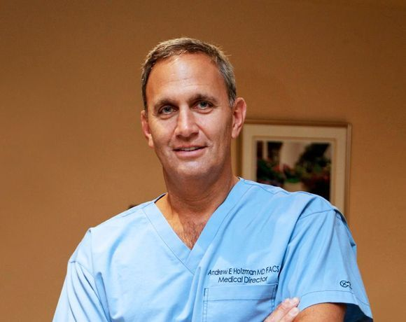 Dr. Holzman
