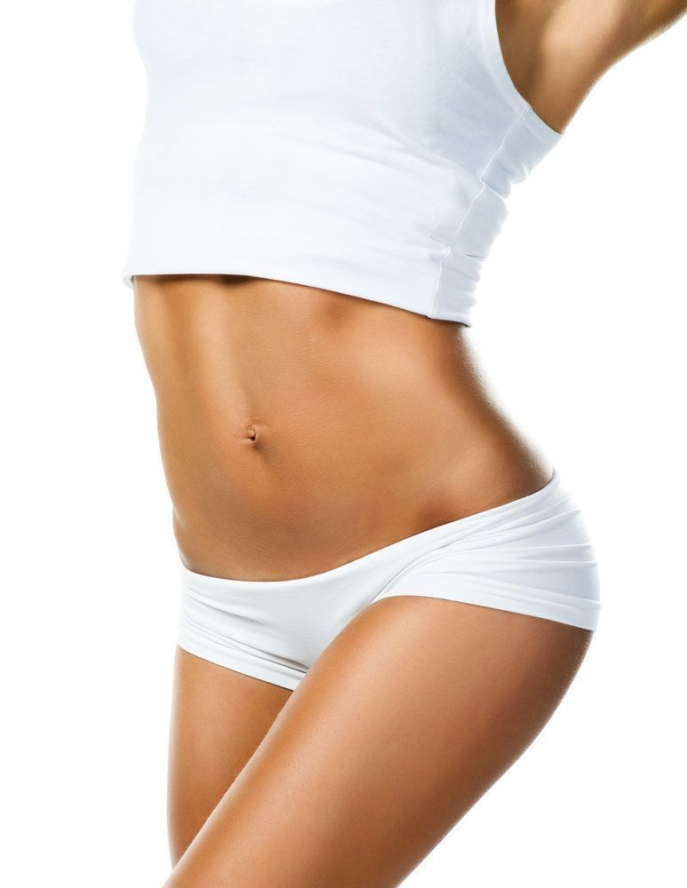 A tan woman wearing a white tank top and white underwear stretches her body into a curved shape.