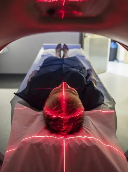 An individual undergoing an MRI.