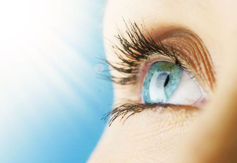 A closeup view of a beautiful blue-green eyeball.