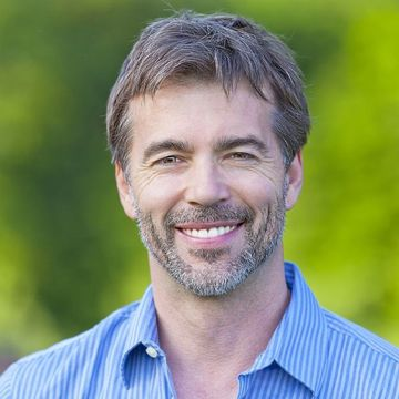 smiling man with graying hair