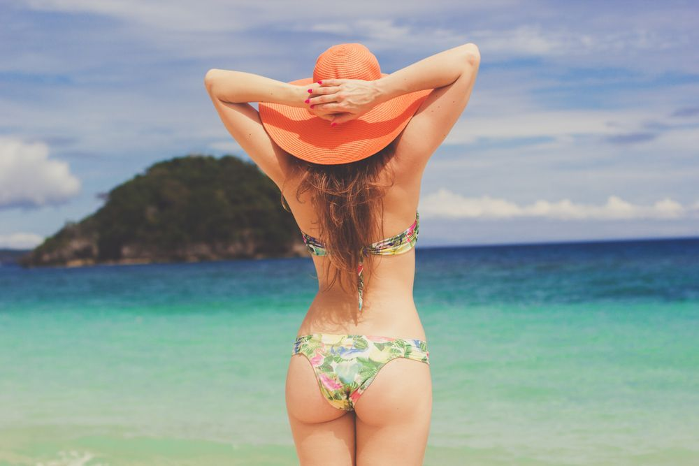 Rear view of woman in bikini on beach