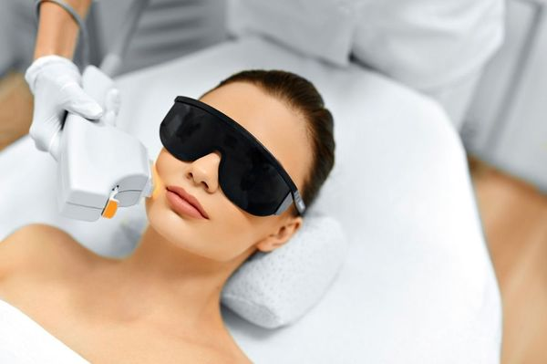 Photo of woman receiving a laser facial