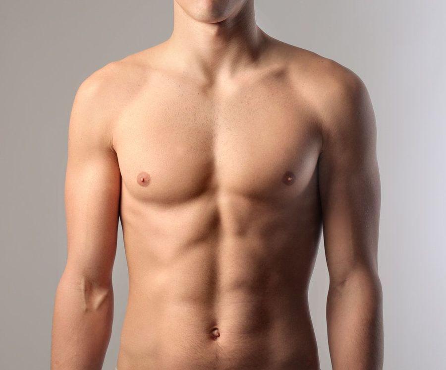 The toned abdomen of a male nude.