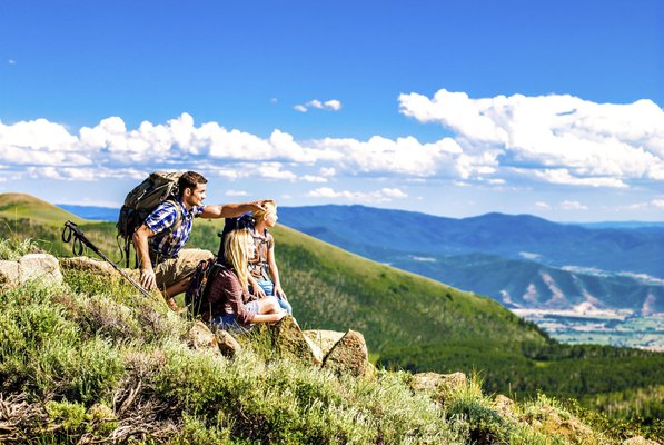Hikers on mountain under bright blue sky