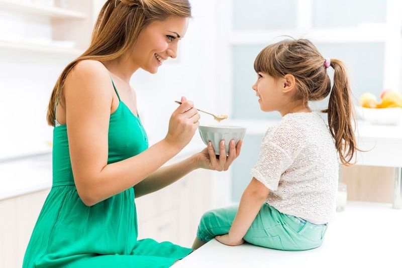 Image of Mother and Daughter eating breakfast