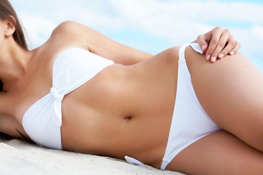 Shapely woman lying on side in white bikini