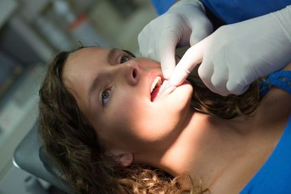 Patient having mouth examined