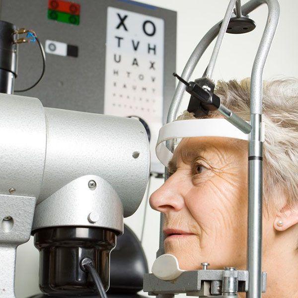 Woman undergoing eye exam