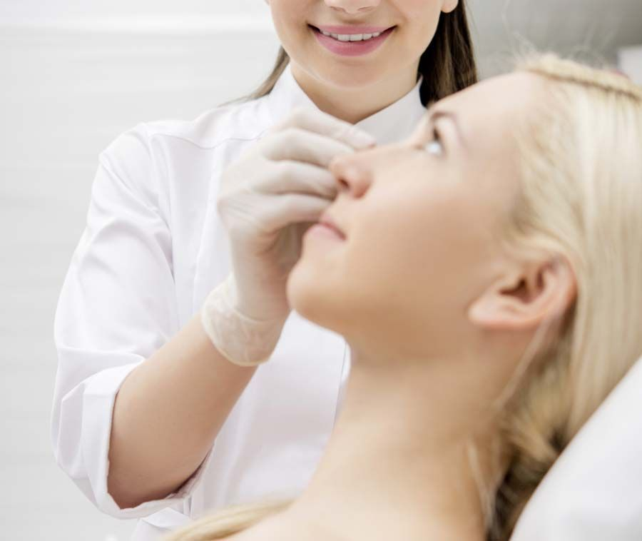 Photo of a woman undergoing esthetic treatments