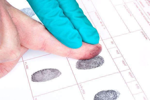 Fingers being fingerprinted.