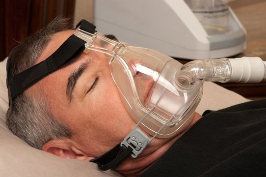 Man using a CPAP machine.