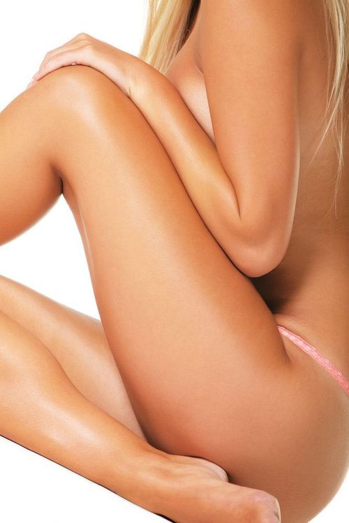 Photo of a tanned, thin woman's body and legs
