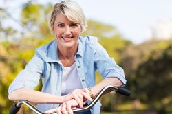 Smiling woman riding bike