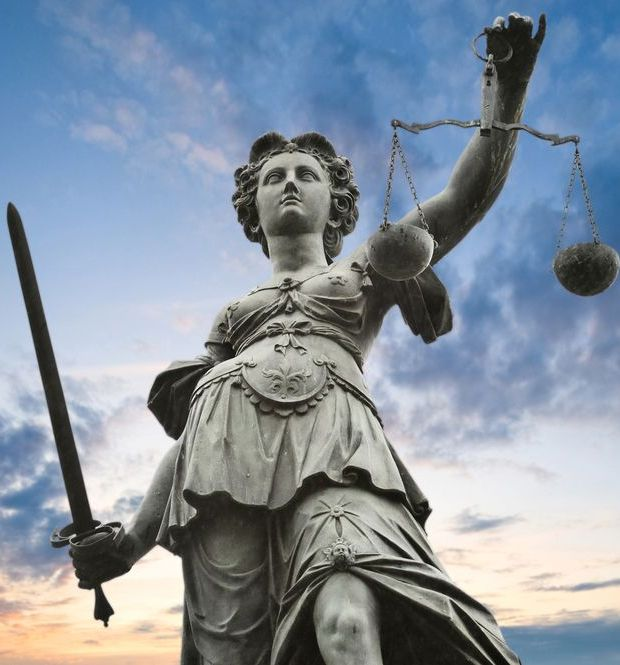 Image of a statue of justice with scales