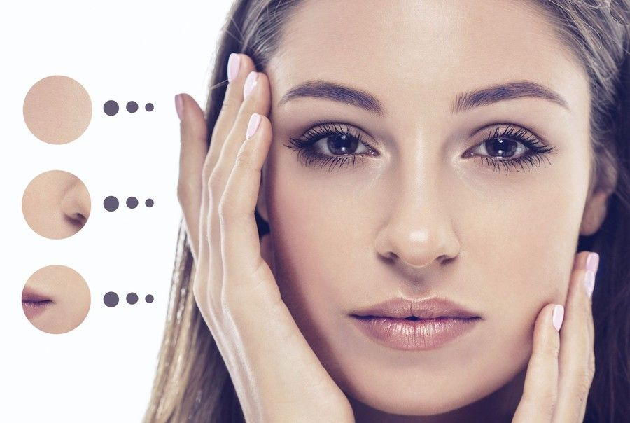 Photo of a woman with hands on her face with areas treatable with BOTOX® highlighted