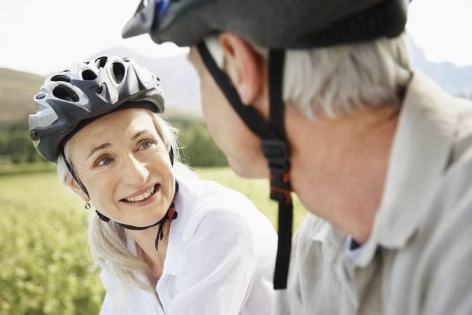 Image of older couples in bike helmets