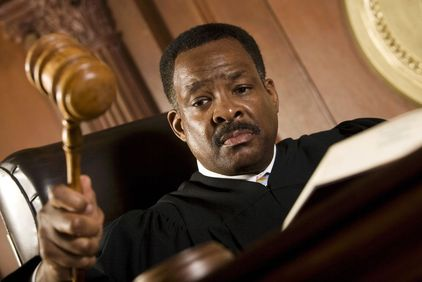 Judge banging gavel in court hearing