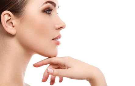 Attractive middle-aged woman resting chin in hands