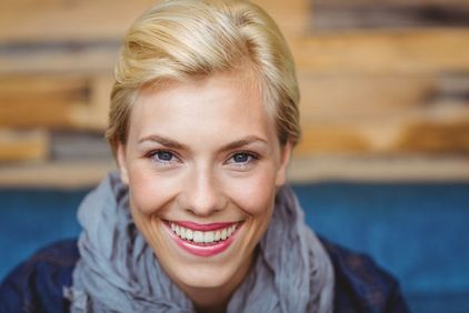 Smiling blonde woman with lipstick