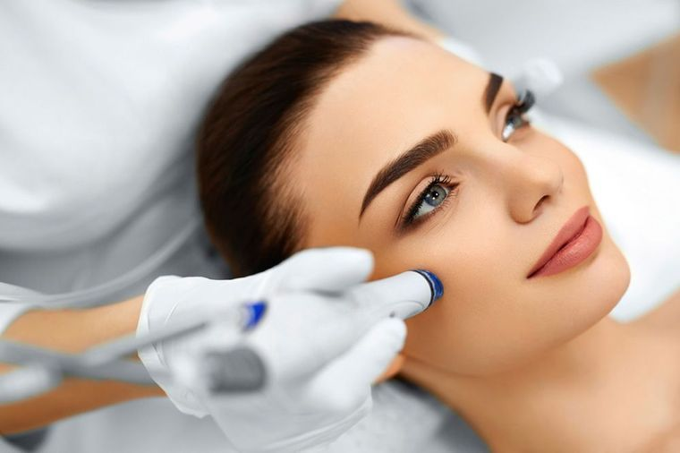 A woman undergoing microdermabrasion