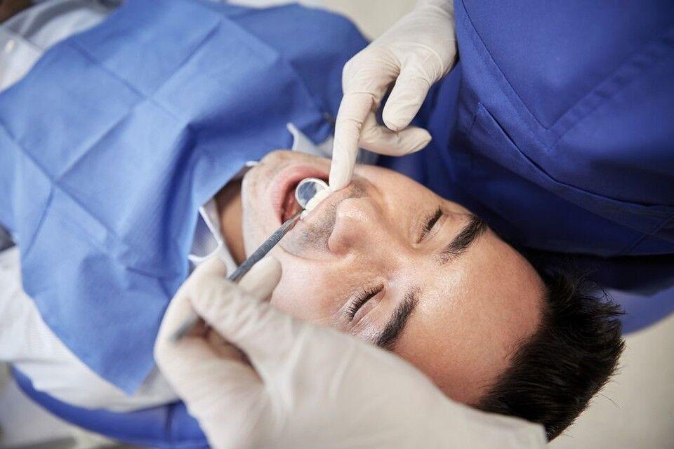 A patient undergoing a dental examination.