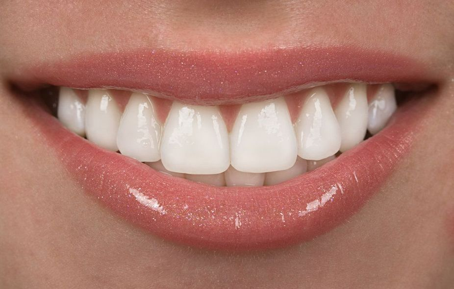 Close up of woman's sparkly lips and teeth
