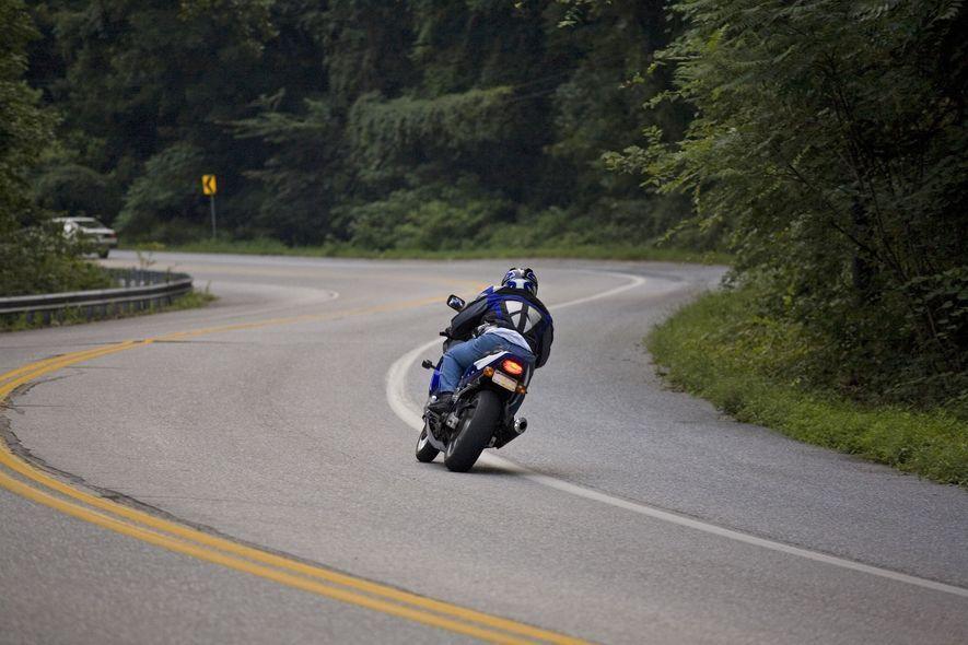 Motorcyclist rounding bend in roadway