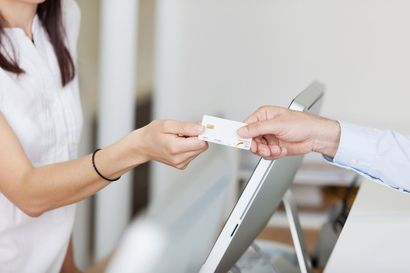 A patient paying for his dental care with a credit card.