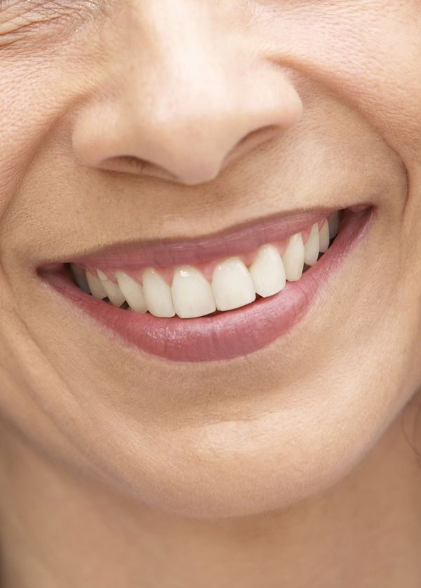 Close-up of a woman's smile.