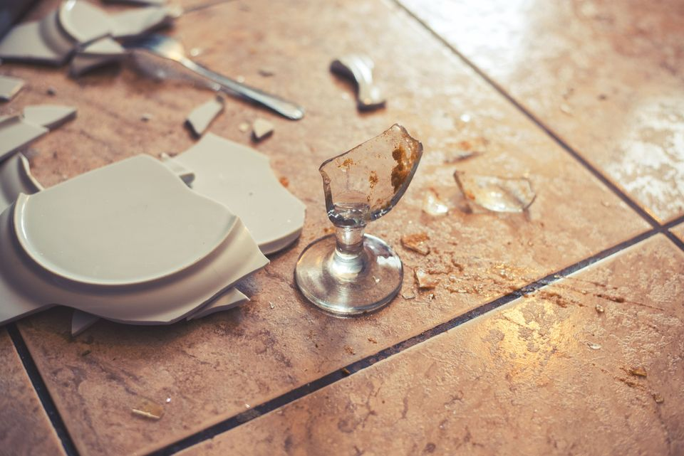 Smashed plate and glass on ground
