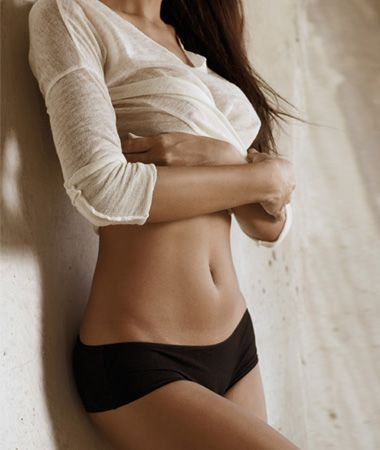 Slim woman baring stomach