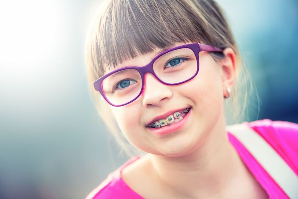 Young girl with glasses and braces