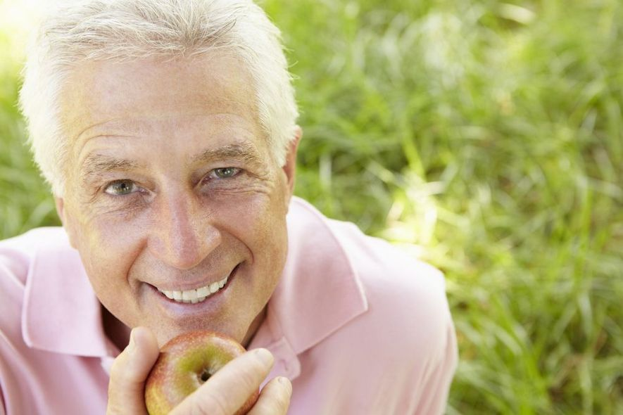 Photo of an older man with an apple