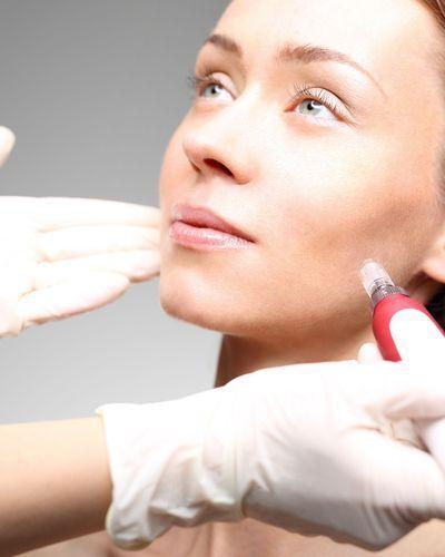 Beautiful woman undergoing cosmetic consultation