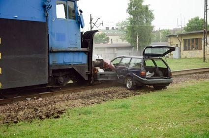 A train crashing into a car