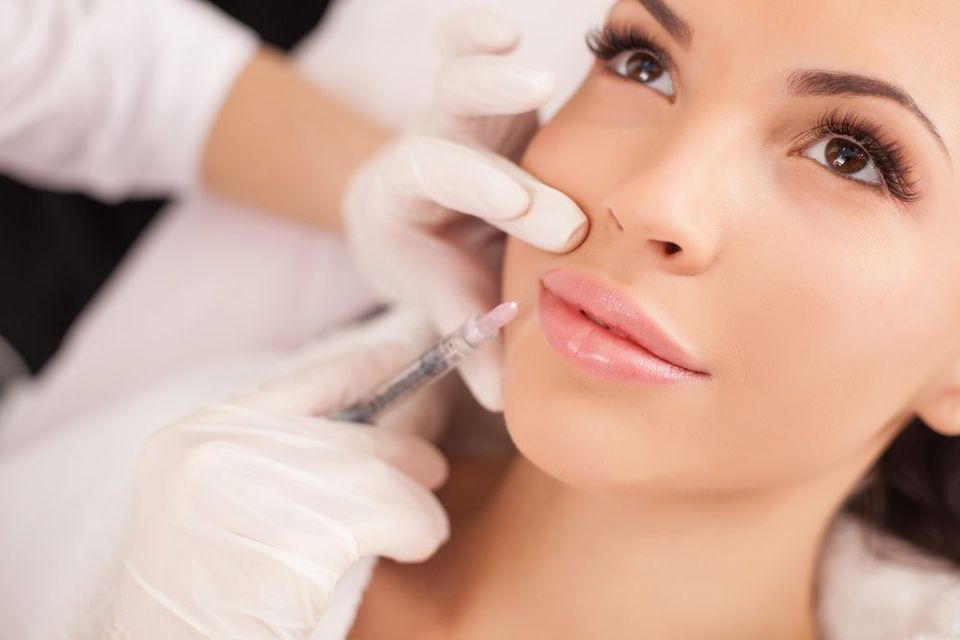A female patient undergoing BOTOX® Cosmetic treatment.