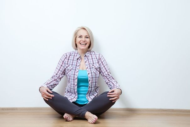 Smiling woman in yoga pose