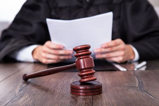 A judge presiding over a case in a courtroom.