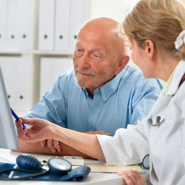Doctor and patient looking at computer monitor